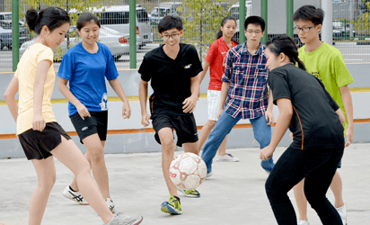 Youths enjoying football at Club Infinity