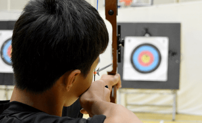 Youths try archery at Club Infinity