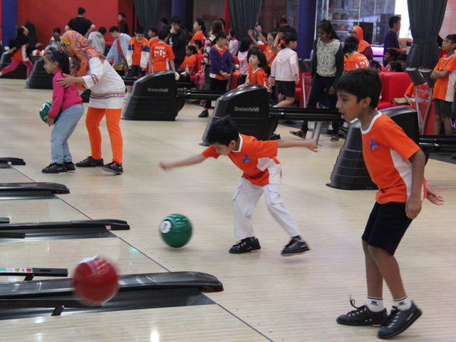 Enjoying a game of bowling during Children's Day