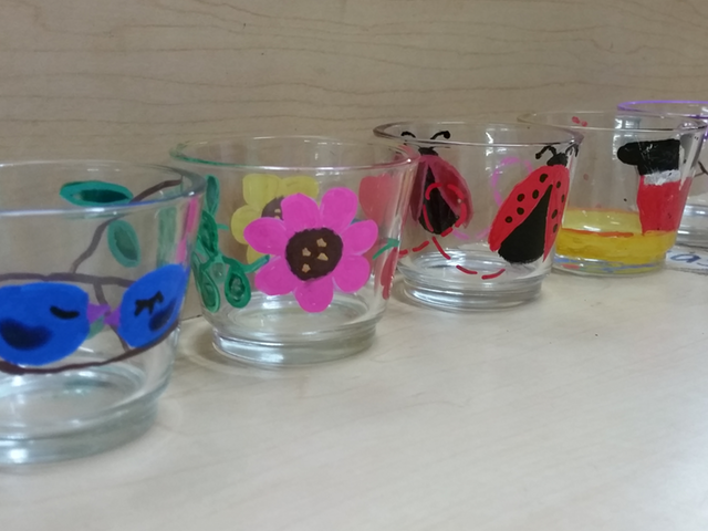 Painted glass cups by children at BASIC